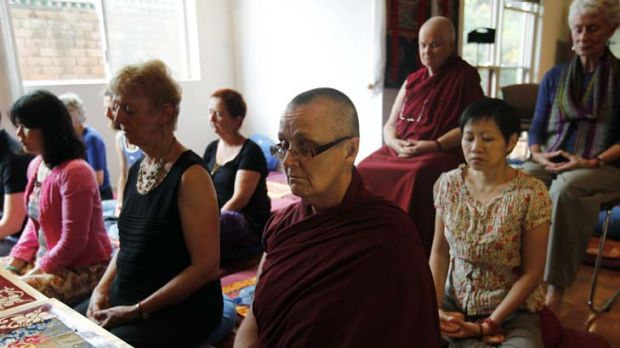Mind matters … Venerable Thubten Chokyi, centre, and other nuns and practitioners meditate at the Vajrayana Institute.
