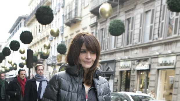 Heart smart casual ... Helena Christensen dresses down for a stroll through the streets of Milan.