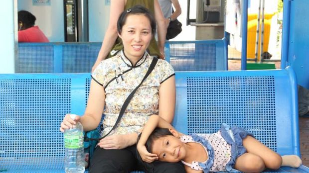 Relief … two of the Chinese Falun Gong practitioners relax in Darwin. They are seeking to continue their journey ...