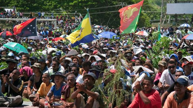 Thousands of Papua New Guineans protest against the government's plan to delay national elections.