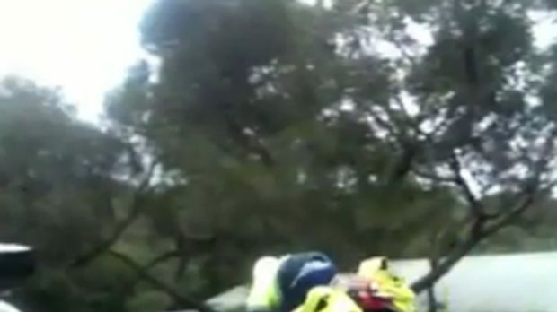 The postie is filmed landing badly after taking the home-made jump at speed in Anglesea.