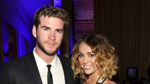 Quick slim ... a newly slender Miley Cyrus poses with boyfriend Liam Hemsworth.