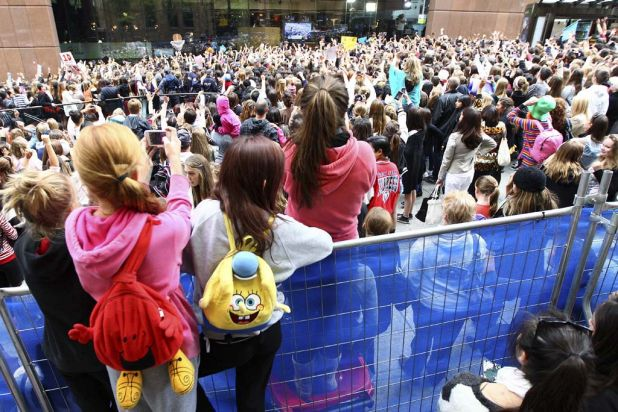 Teenage girls gather in Martin Place for a glimpse of One Direction.