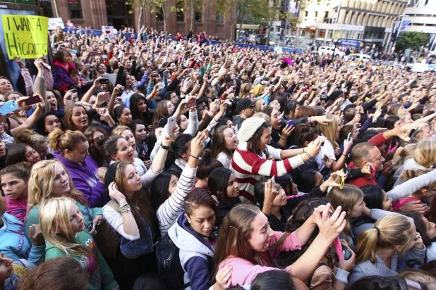 Teenage girls gather in Martin Place in Sydney's CBD for a glimpse of One Direction.