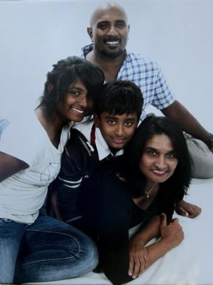 'I would have been killed'' ... Premakumar Gunaratnam with his wife and children in a family photo taken last year.