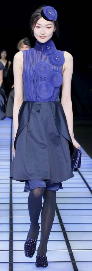 Free spirits ... a model wears designs from Emporio Armani's autumn-winter 2012 womenswear lines in Milan.