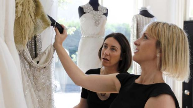 Dress up ... editor Edwina McCann (left) looks at gowns with designer Johanna Johnson.