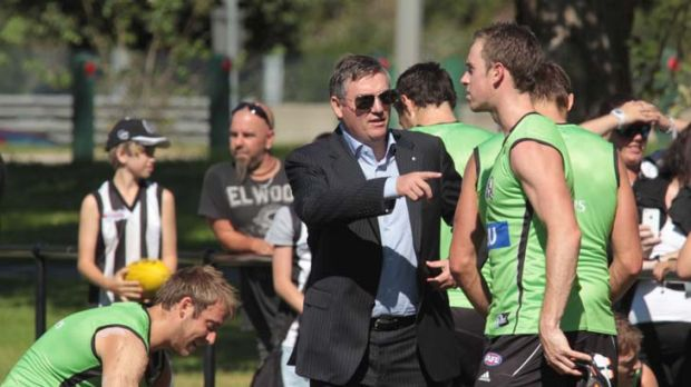 Pointing the way: Collingwood president Eddie McGuire with skipper Nick Maxwell at training yesterday.