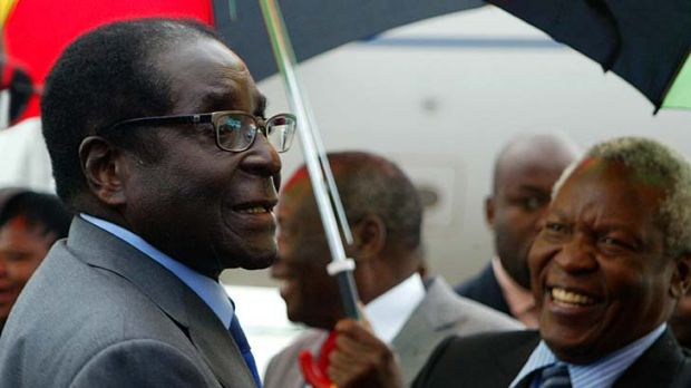Robert Mugabe arrives home in Zimbabwe as officials brushed aside reports that he is gravely ill.