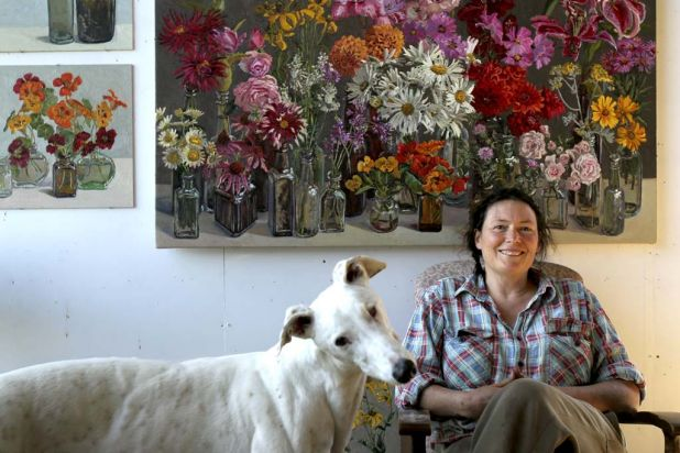 Lucy Culliton with her greyhound Earl in her studio on her property, Bibbenluke Lodge.