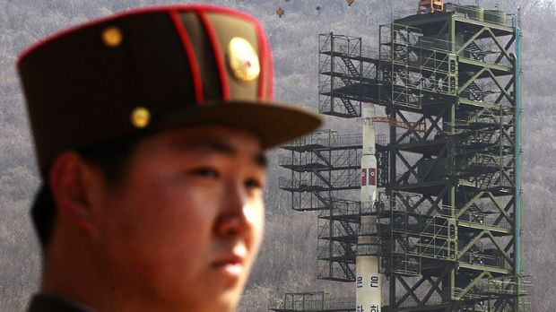 A North Korean soldier stands guard at the rocket site before the launch.