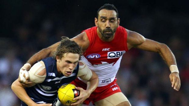 Gotcha … Billie Smedts of the Cats is tackled by Adam Goodes in the NAB Cup.