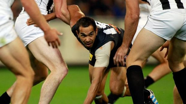 Blues forward Eddie Betts, who kicked five goals, sneaks between two Collingwood defenders.