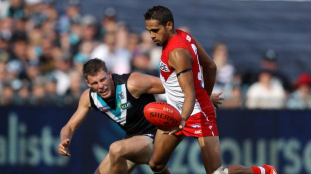 Lewis Jetta of the Swans evades Brad Ebert of the Power yesterday.
