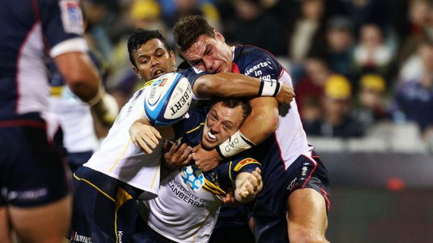 Jolted ... Jesse Mogg of the Brumbies drops the ball in the tackle.
