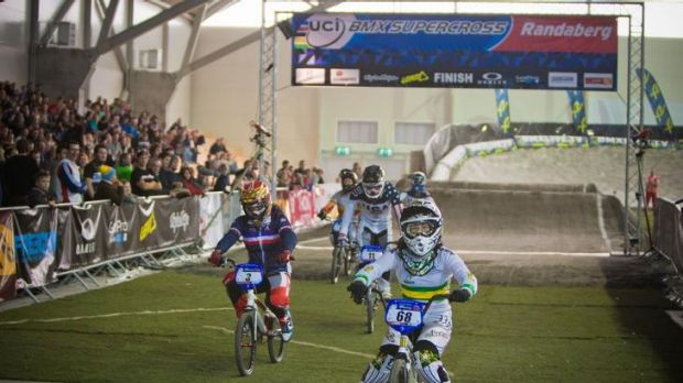 Caroline Buchanan, right, takes out the BMX World Cup in Norway yesterday.