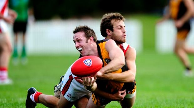 Queanbeyan's Toby Conroy and Eastlake's Sam Mardling get up close and personal yesterday.