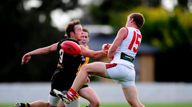 Queanbeyan's Will Griggs and Eastlake's Sam Smith vie for possession.