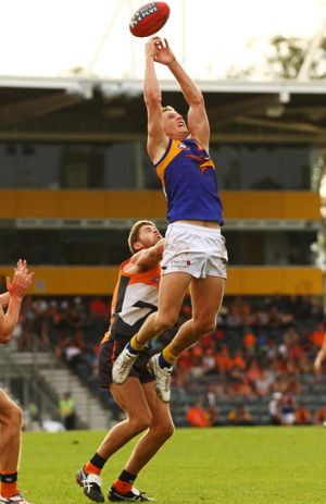 Higher, higher: Scott Selwood's marking attempt falls short during the Eagles' 81-point victory against the Giants.
