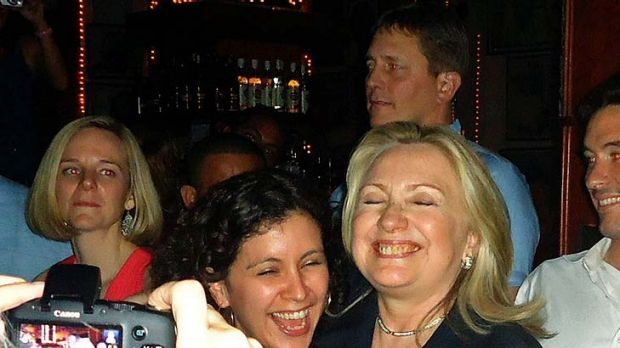 State of euphoria ...  Hillary Clinton dances with members of her delegation in the Cafe Havana salsa bar  during a ...