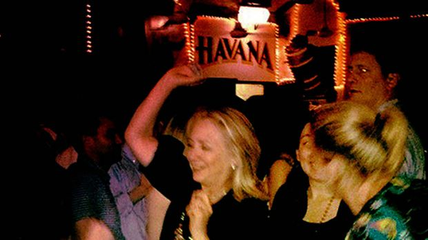 Diplomatic nights ... Clinton was pictured cutting up the dancefloor at the bar, known for its Cuban music.