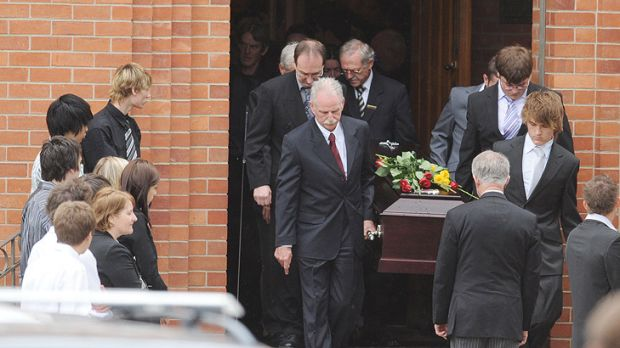 Pall bearers carry Justin Galligan's casket at his 2008 funeral.
