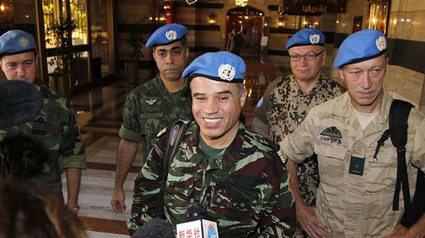 Colonel Ahmed Hommich, a member of a UN monitoring team, speaks to the media at a hotel in Damascus yesterday.