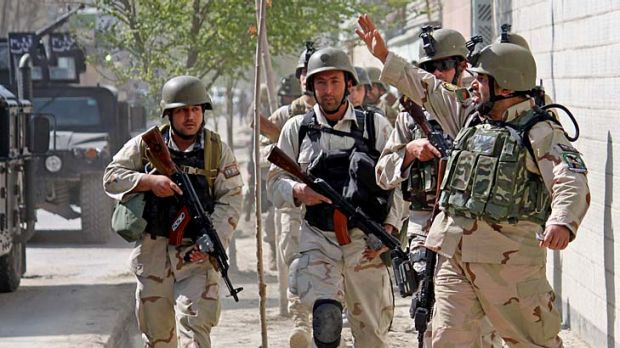 Afghan security forces take up positions in Kabul during the insurgent raids on the capital.