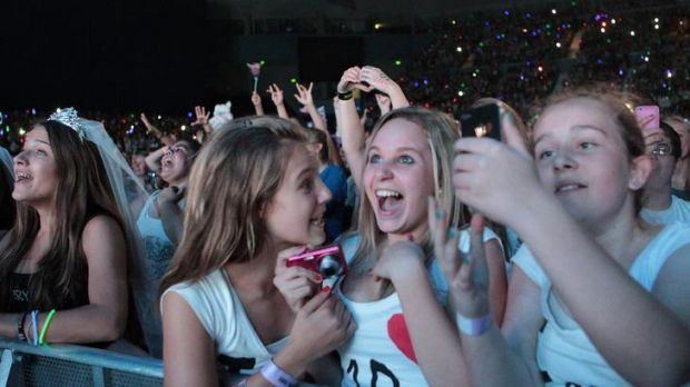 Delirious teenagers squeal their delight during the concert at Hisense Area last night of British boy band One Direction.