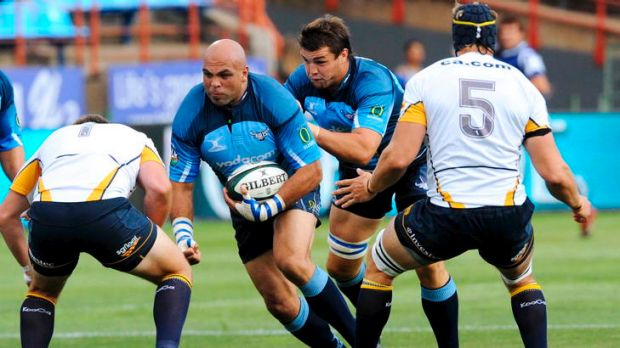 Brumbies prop Ben Alexander prepares to tackle Gurthro Steenkamp of Bulls the last time the teams met at Loftus Versfeld ...