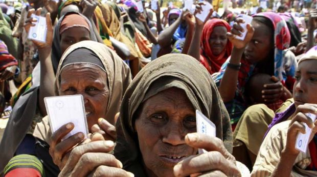 In need ... displaced women waiting to receive non-food items from the United Nations High Commissioner for Refugees in ...