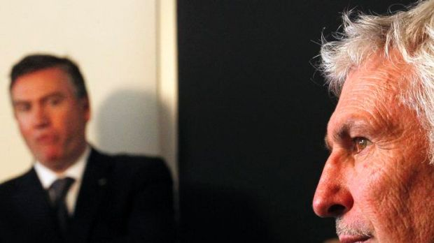 Eddie McGuire looks on as then coach Mick Malthouse speaks to the media.