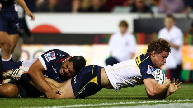 Michael Hooper of the Brumbies scores during the round eight Super Rugby match between the Brumbies and the Rebels at ...