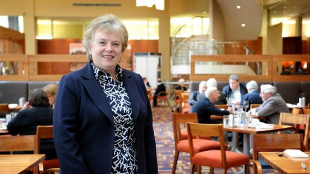Manager Sue Blake in a club dining room.
