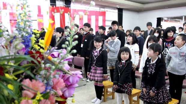 Pupils have been welcomed back to their school in the village of Kawauchi, near the Fukushima nuclear plant.