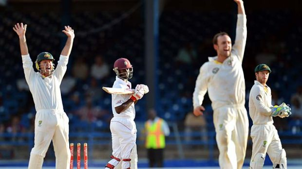 Australia's Ricky Ponting, left, Nathan Lyon, second right, and Matthew Wade, right, make a conventional appeal for the ...