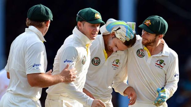 Australian wicketkeeper Matthew Wade, right, rubs the head of  Nathan Lyon after the wicket of West Indies batsman ...