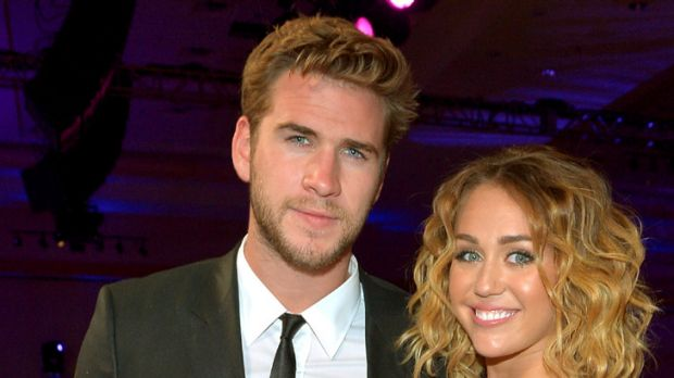 Engaged ... Miley Cyrus and Liam Hemsworth.