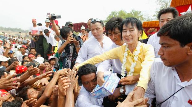 Aung San Suu Kyi … invited to visit Britain by Prime Minister David Cameron.