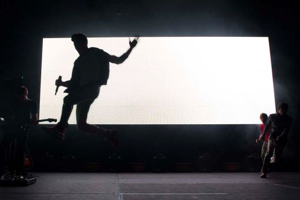 Zayn Malik of One Direction makes his entrance on stage at the Brisbane Convention and Exhibition Centre.