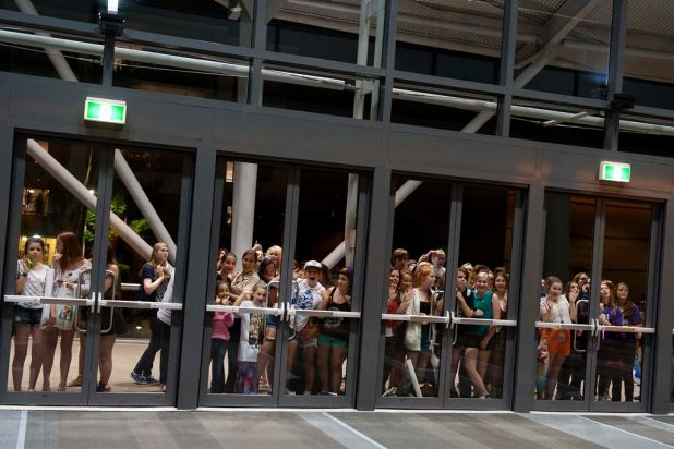 Fans wait outside as One Direction performs at the Brisbane Convention and Exhibition Centre.