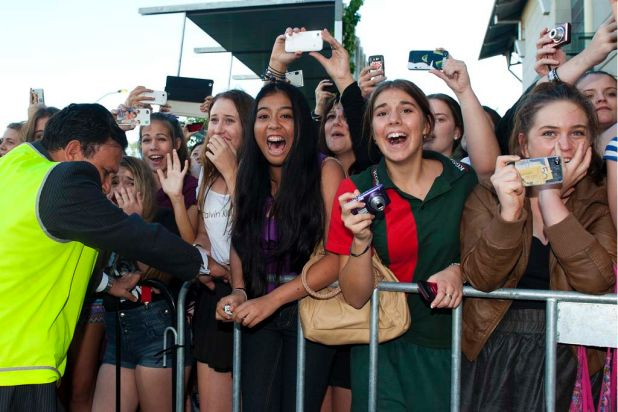 Fans scream as One Direction for their concert at the Brisbane Convention and Exhibition Centre.