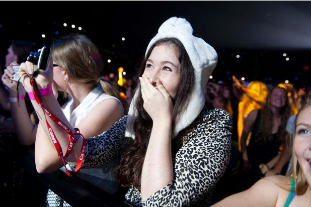 Emotional fans watch as One Direction performs at the Brisbane Convention and Exhibition Centre.