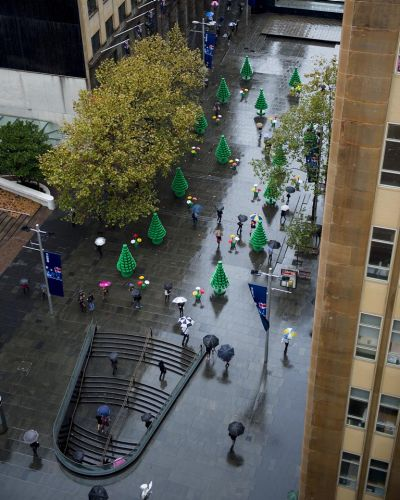 Sydneysiders walk through the LEGO Forest in Martin Place, Sydney.  Photographed by Dominic Loneragan.
