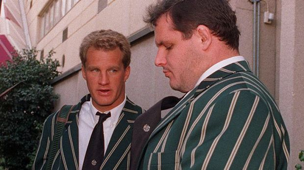Michael Lynagh and Ewen McKenzie await a bus during their Wallabies playing days.
