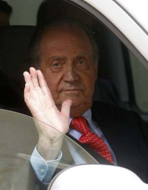 Rushed back ... Spain's King Jaun Carlos emerges from hospital after being treated for a fractured hip.