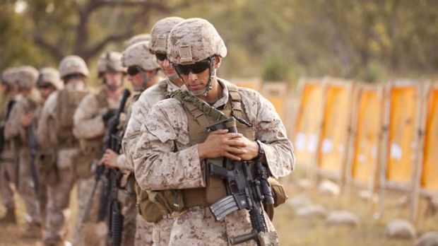 Ready, aim ... Lance-Corporal Carlos Vasquez of Fox Company USMC takes part in combat marksmanship training at Kangaroo ...