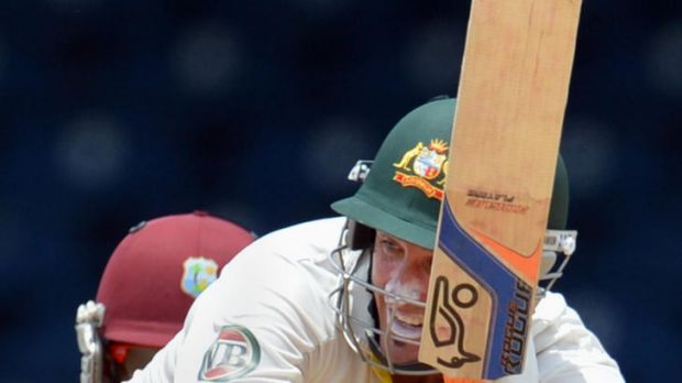 Australian batsman Michael Hussey plays a shot during the final day of the second Test before the match was rained out.