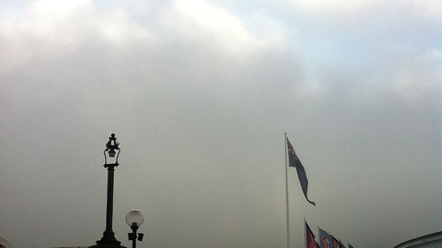 Fog covers the skyline in this photo taken from Pyrmont Bridge.