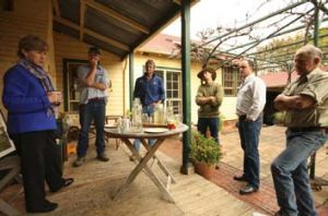 Green tea ... Milne addresses local farmers over some light refreshments.